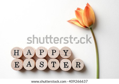 Closeup of fresh flower and Easter text isolated over white background - stock photo