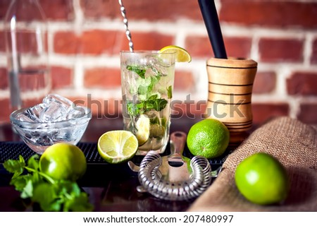 closeup of fresh made mint cocktail drink served cold at restaurant - stock photo
