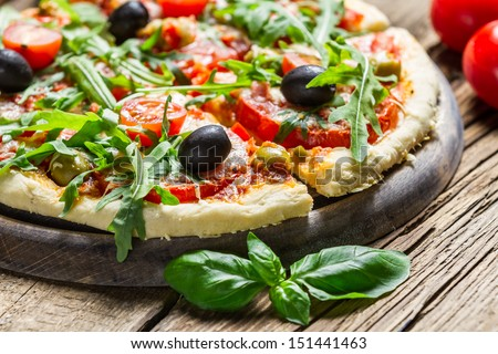 Closeup of fresh pizza with vegetables - stock photo