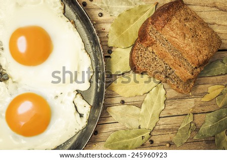 Closeup of fried egg on a cast iron pan - stock photo
