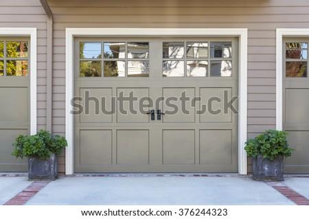 Closeup of garage door with windows - stock photo