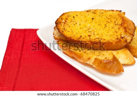 closeup of garlic bread against white background - stock photo