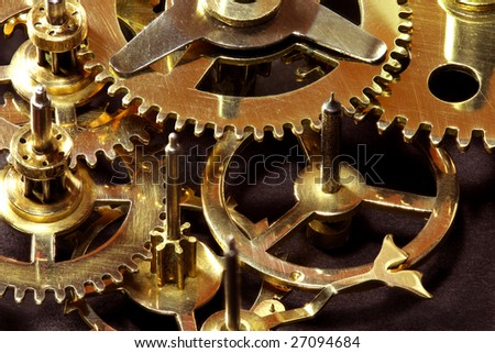 Closeup of gears from old clock works. - stock photo