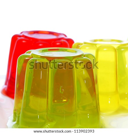 closeup of gelatin of different colors on a white background - stock photo