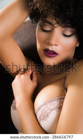 closeup of girls face in lingerie with sensual pose - stock photo