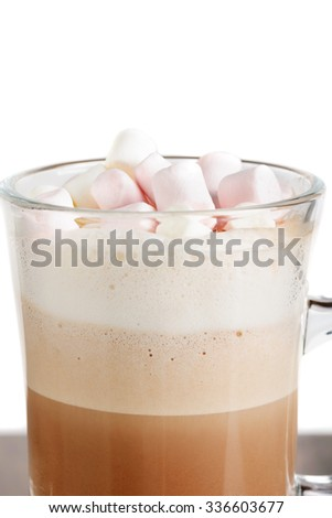 Closeup of glass hot chocolate with marshmallows against  - stock photo