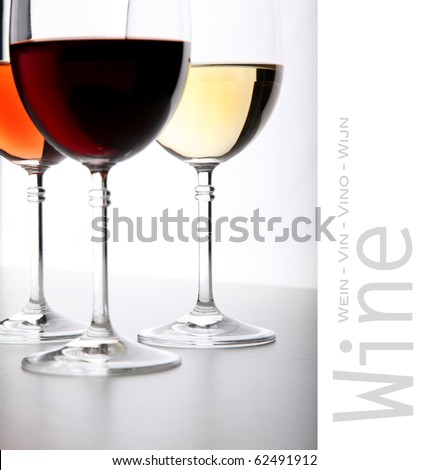 Closeup of glasses full of wine on grey background - stock photo