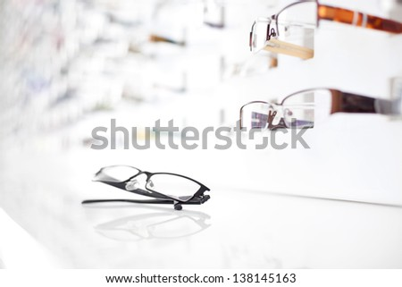 Closeup of glasses with many eyeglasses in background - stock photo