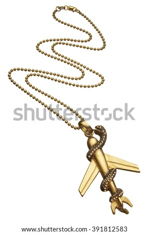 Closeup of golden snake and plane shaped pendant hanging from chain against white background - stock photo
