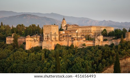 Closeup of Granada and the ancient arabic fortress of Alhambra at dusk with Sierra Nevada in the background. Spain. - stock photo