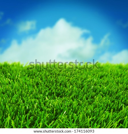 closeup of grass over the blue sky with a retro effect - stock photo