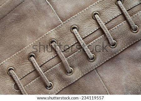 Closeup of gray suede background with lacing - stock photo