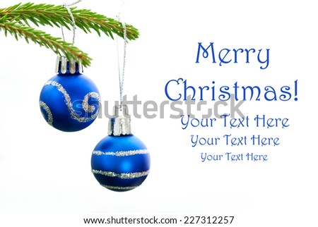 Closeup of Green Christmas Fir Tree With Two Blue Christmas Balls Whith Silver Decoration On It And Your Text Here, White Background, Merry Christmas - stock photo