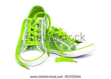 Closeup of green sneakers with shoelaces isolated on white background - stock photo