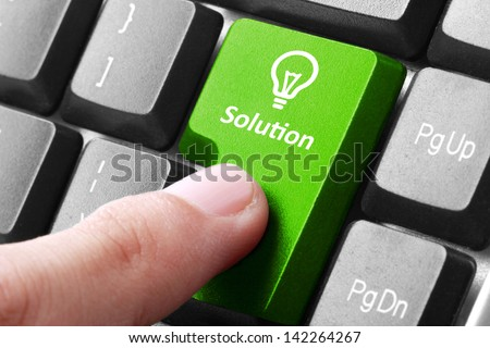 Closeup of green solution button on the keyboard - stock photo