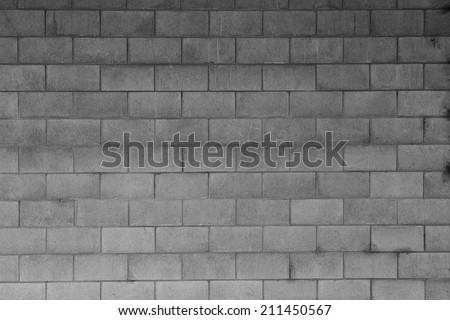 Closeup of grey block wall - stock photo