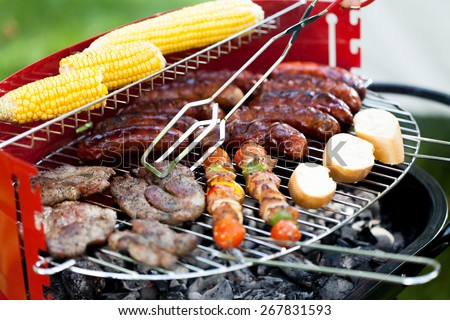 Closeup of grill full of delicious food - stock photo