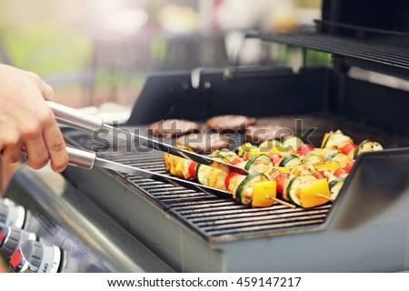 Closeup of grilled shashliks on grate - stock photo