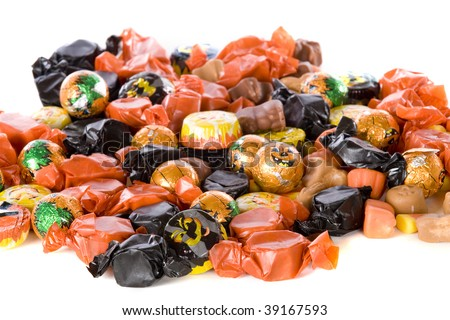 Closeup of Halloween candy -- mostly wrapped in orange and black.  Isolated on white. - stock photo