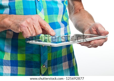 Closeup of hand from senior man using tablet. - stock photo