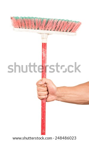 closeup of hand holding a broom isolated on white - stock photo