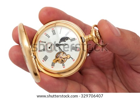Closeup of hand holding pocketwatch on white background - stock photo