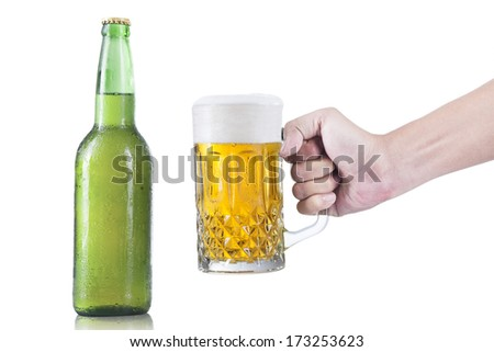 Closeup of hand taking a glass of beer, isolated on a white background. - stock photo