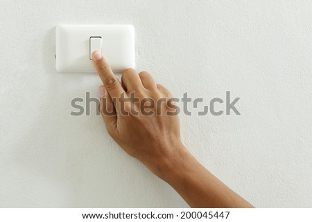 closeup of hand touch electric-switch  - stock photo