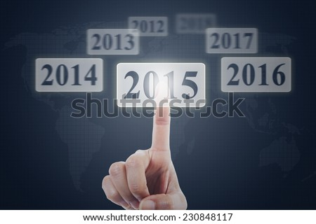 Closeup of hand touching number 2015 on a modern virtual screen - stock photo