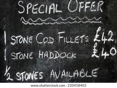 Closeup of hand written sign offering fish for sale on fish market - stock photo