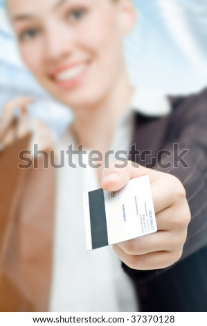 Closeup of hands holding new credit card - stock photo