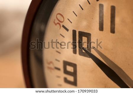 Closeup of hands on clock face  Clock. Time concept. Macro image.   - stock photo