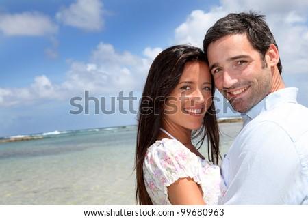 Closeup of happy couple on honeymoon travel - stock photo