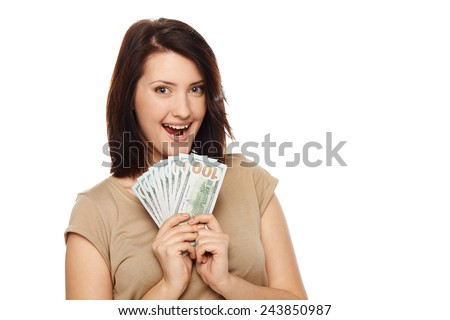 Closeup of happy excited young beautiful woman with us dollar money in hand over white background, with copy spac - stock photo