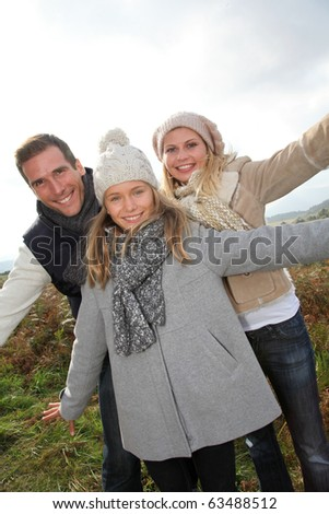 Closeup of happy family in fall season - stock photo