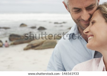 Closeup of happy loving couple spending leisure time together at beach - stock photo