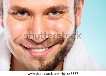 Closeup of happy man with half shaved face beard hair. Smiling handsome guy on blue. Skin care and hygiene. - stock photo