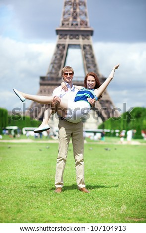 Closeup of happy positive couple having fun near the Eiffel tower - stock photo