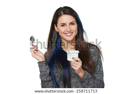 Closeup of happy smiling healthy woman eating yoghurt isolated on white - stock photo