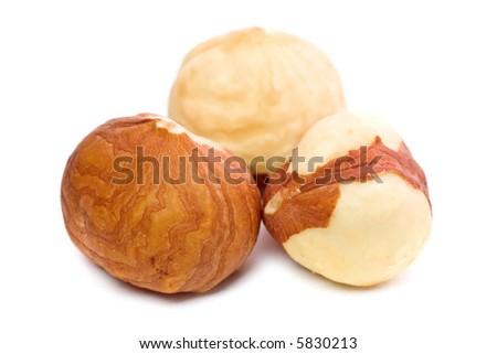 Closeup of hazel nuts kernels isolated on white background. - stock photo