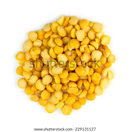 Closeup of heap of yellow chana split peas isolated against white - stock photo