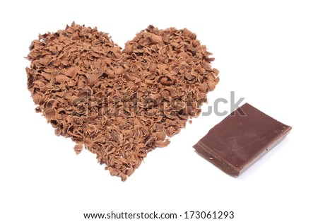 Closeup of heart shaped grated chocolate and portion of chocolate, valentine heart of chocolate. Isolated on white background - stock photo