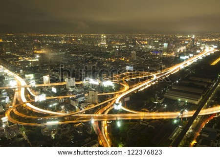 Closeup of highest Aerial view of Bangkok Highway Cityscape at Dusk in Thailand - stock photo