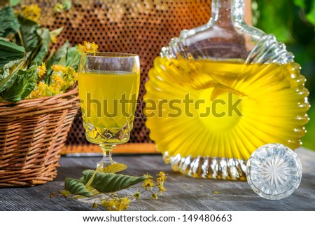 Closeup of homemade liqueur with lime and honey - stock photo