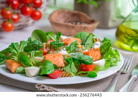 Closeup of homemade salad with salmon and vegetables - stock photo