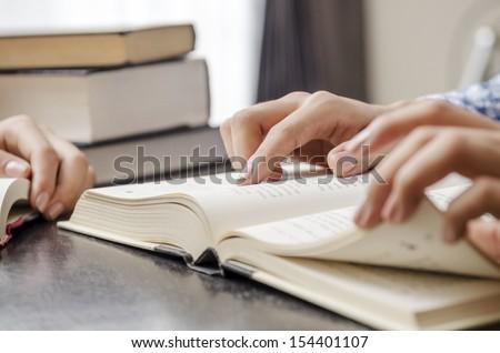 Closeup of human hand reading - stock photo