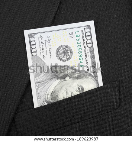 Closeup of hundred dollar bills in suit pocket - stock photo