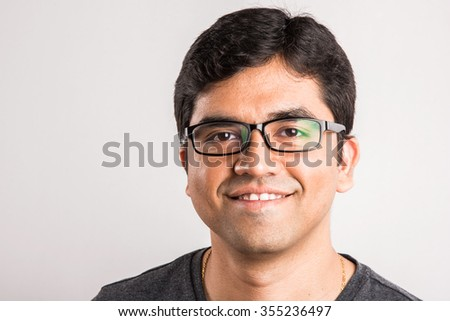 closeup of indian man with glasses, smiling asian man wearing glasses, Closeup portrait of young indian man in glasses, portrait of a handsome indian happy man, asian happy man - stock photo