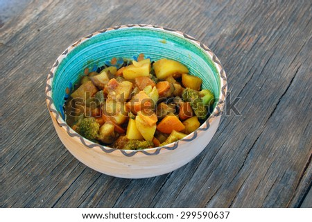 closeup of Indian meal. fresh seasonal vegetables with curry sauce - stock photo
