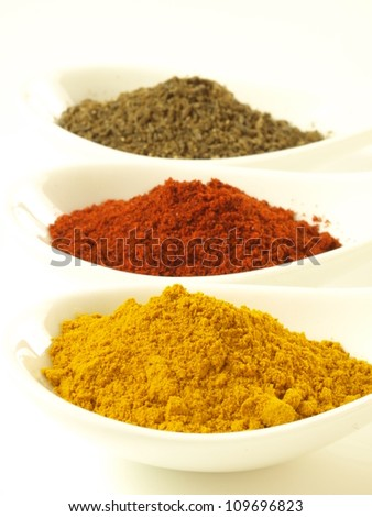 Closeup of indian spices: cumin, turmeric and pepper - stock photo